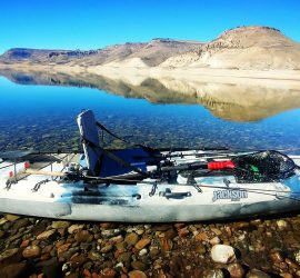 Kayak fishing guide Stormy Cochran's Jackson Kayak the Iron Maiden Fall Lake trout trolling on Blue Mesa in Gunnison, Colorado.