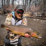 GSO Fishing Guide Hunter Pierson with a large river trout