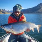 Gunnison Sports Outfitter Guide Hunter Pierson with huge Colorado Blue Mesa Lake Trout