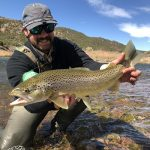 Gunnison Sports Outfitters Fly Fishing Guide Irah Wooten with a nice Colorado trout.