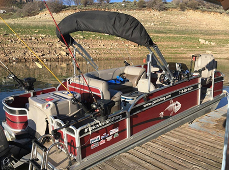 Gunnison Sports Outfitters fishing guide Kyle Jones' Blue Mesa Premier Pontoon Boat at the Elk Creek Marina dock.