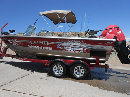 Gunnison Sports Outfitters fishing guide Randy Sandoval's guide boat loaded on the trailer after taking it out of Blue Mesa Reservoir.