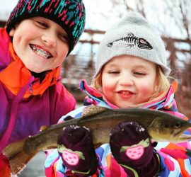 Youth Anglers Winter Fishing with Gunnison Sports Outfitters in Gunnison, Colorado catching Brown trout.