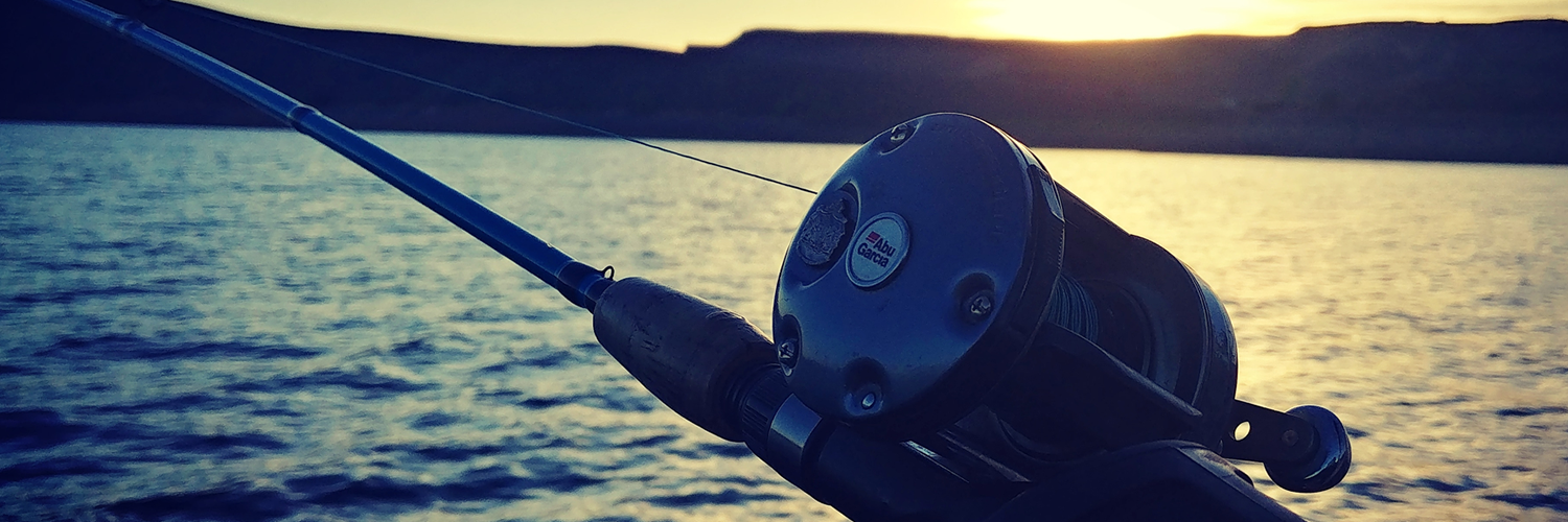 Gunnison Sports Outfitters in Gunnison Colorado sunset fishing on Blue Mesa Reservoir with their Abu Garcia fishing reel.