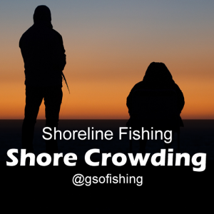 Shore Crowding: Anglers fishing at sunset close together on the shoreline.